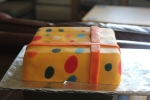 Gift-wrapped birthday cake with bow birthday present cake birthday gift cake cake decoration gift wrapping gift wrapped