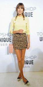 Yellow Jumper £60 Miniskirt £38 both Topshop
